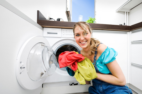 Woman taking clothes out of dryer