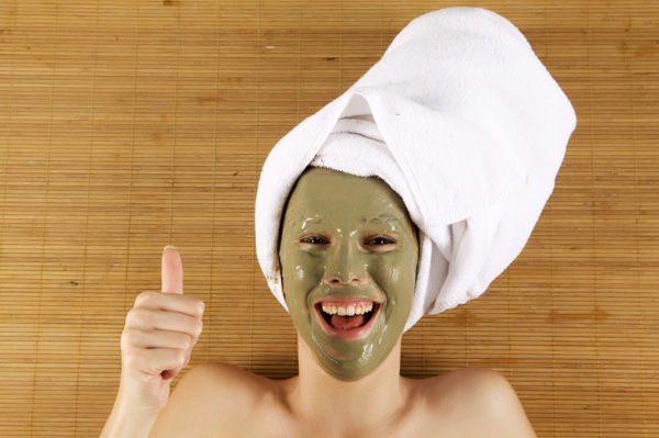 Woman wearing green mud mask