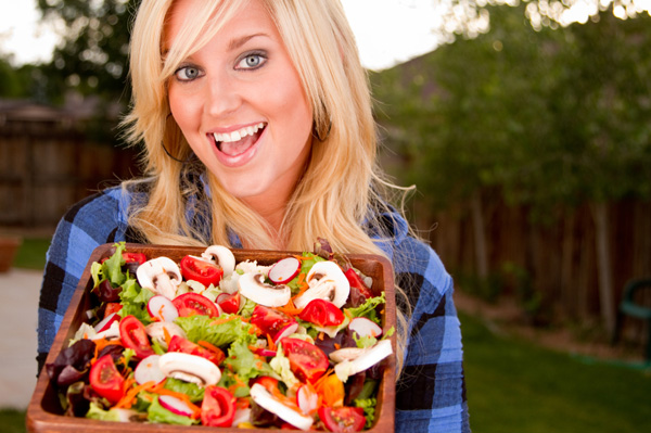 Woman with garden salad