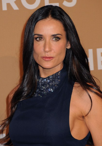 Demi Moore looks stunning with her glossy dark long locks and soft