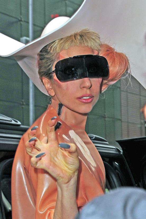 Gaga turns heads in flesh colored costume