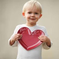 boy holding heart
