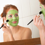 Woman applying homemade beauty mask treatment