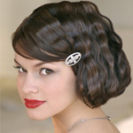 Brunette woman with short bob haircut with bangs