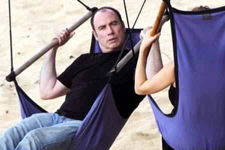Travolta embraces his bald side