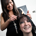 Brunette woman getting her hair cut