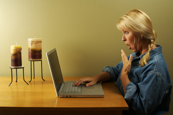 shocked woman on computer