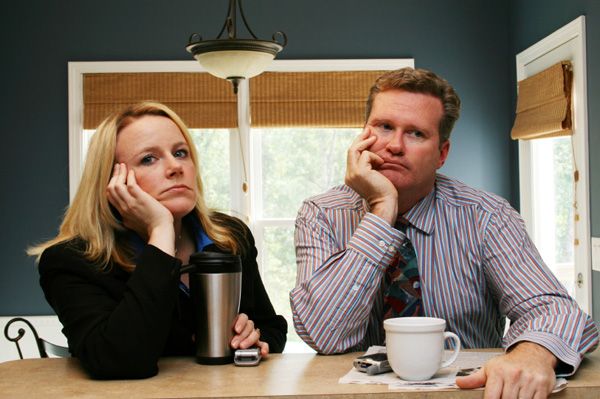 Unhappy couple drinking coffee.