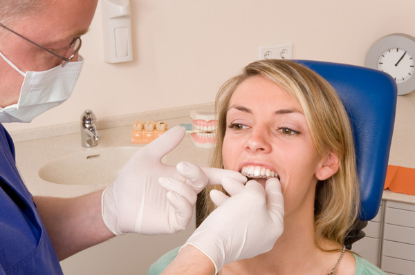 Woman being fitted for braces