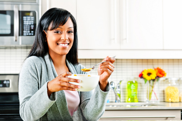Woman eating healthy cereal
