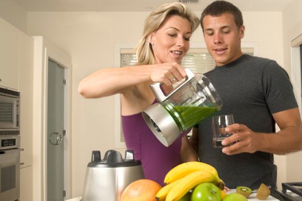 Woman pouring smoothie