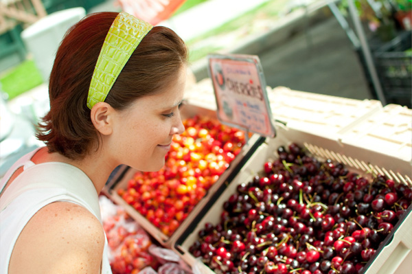 Woman eating organic cherries