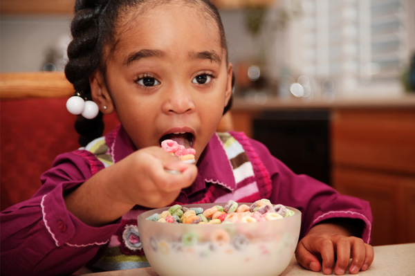 Girl eating sugar cereal