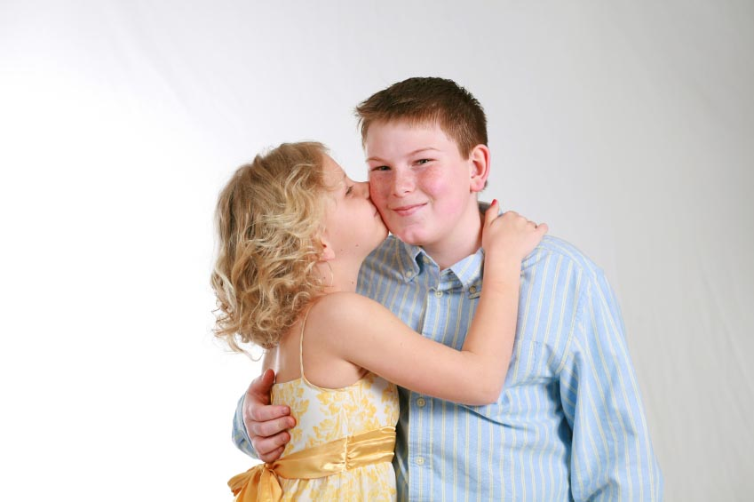girl kissing boy on cheek