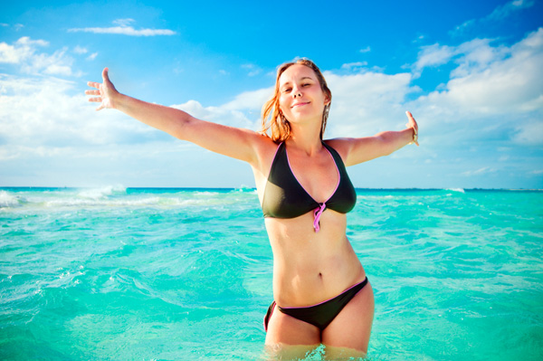 Happy woman wearing bathing suit