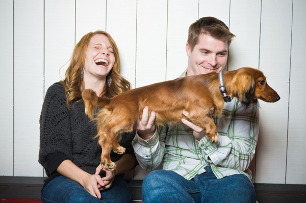 Laughing couple with dog