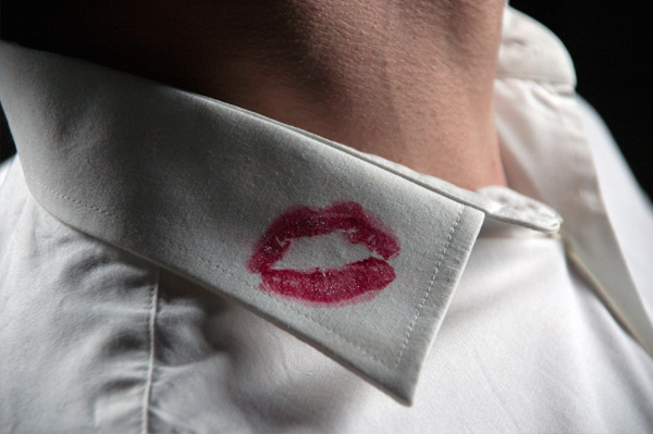 Man with lipstick on shirt