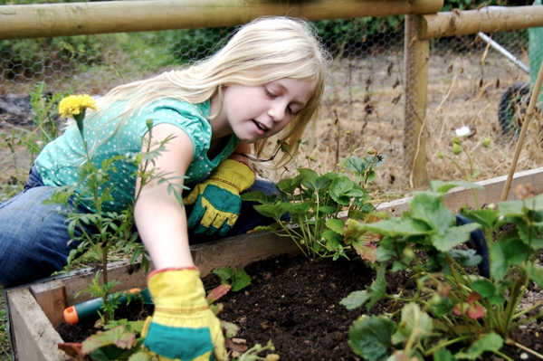 tween girl gardening