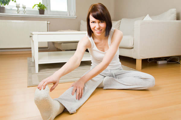 Woman stretching in living room