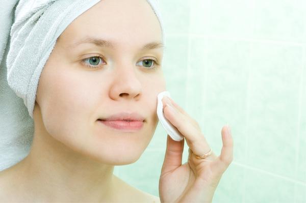 Woman using facial toner