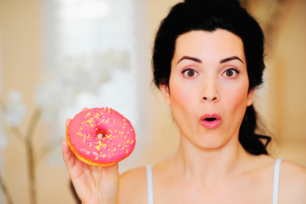 Woman with sugary donut