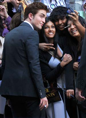 Robert Pattinson signs autographs for fans