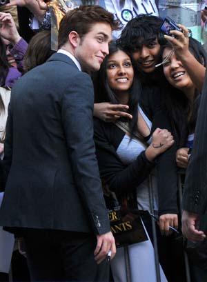Robert Pattinson signs autographs for fans
