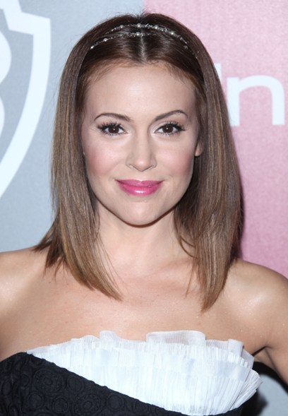 Alyssa Milano with a headband hair accessory