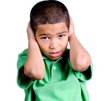 child covering ears