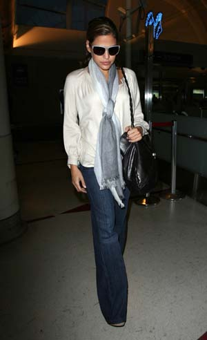 Eva Mendes leaving LAX in flare jeans