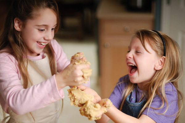 Kids making peanut butter playdough