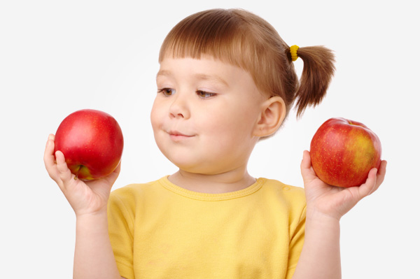 Little girl counting apples