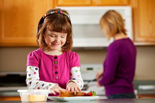 Little girls making sandwich