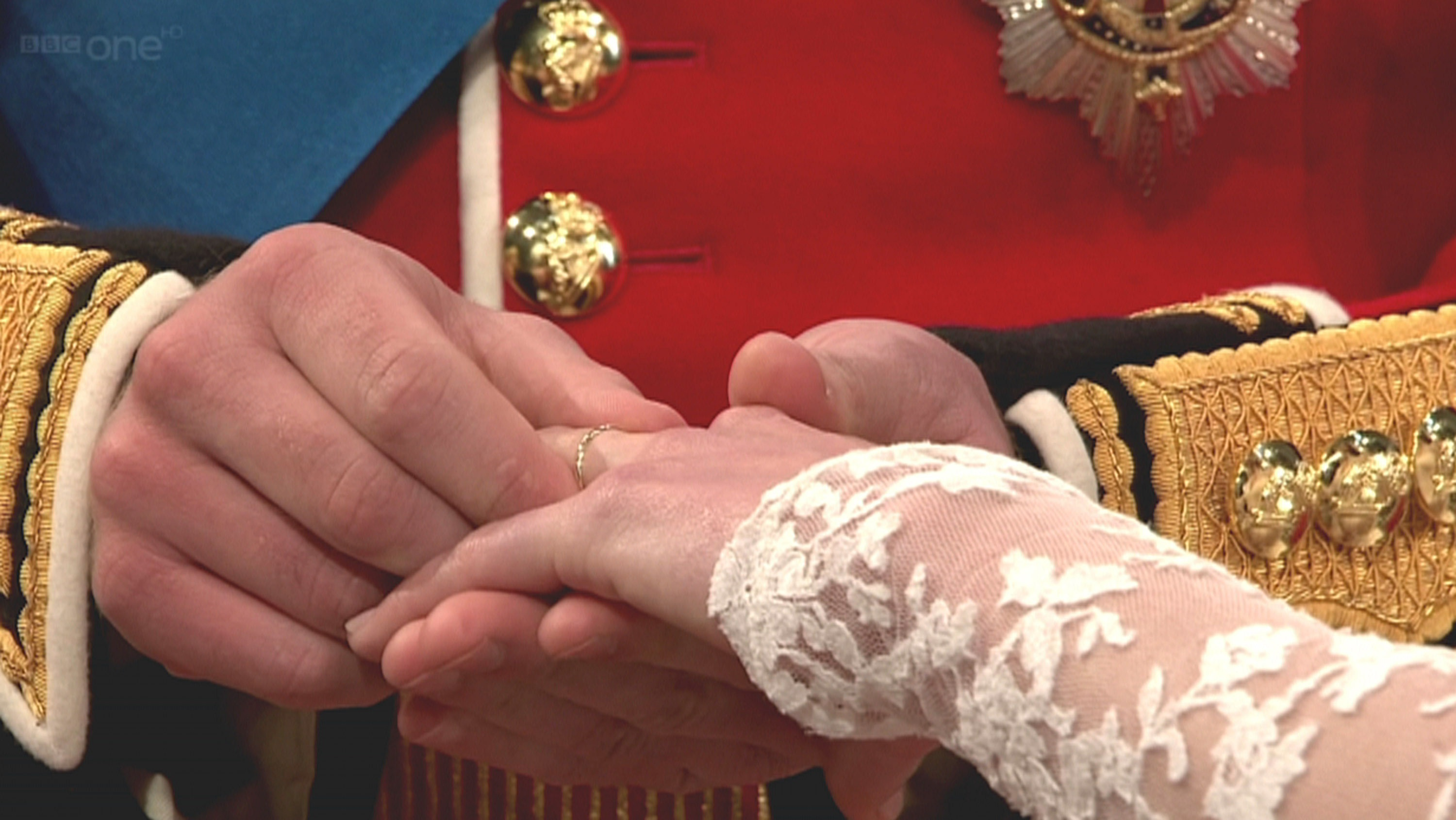 Prince William puts wedding ring on Kate Middleton's well manicured finger