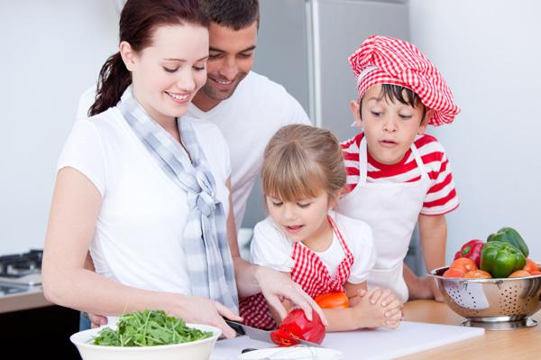 Mom and kids making salad