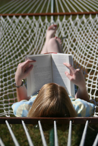 Mom reading book in hammock