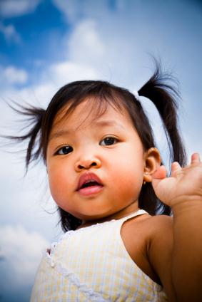 Little girl waving goodbye