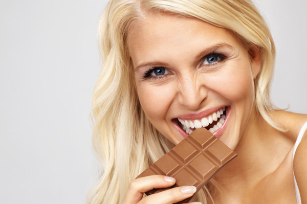 Woman eating chocoalte bar