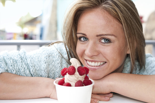 Woman eating frozen yogurt