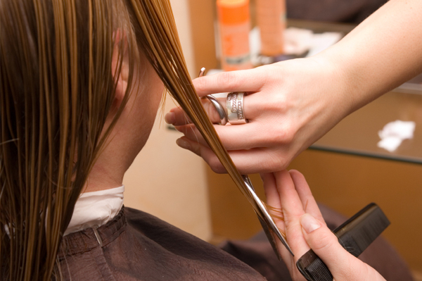 Woman getting angled haircut