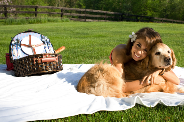 Woman having picnic with dog