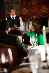 Woman talking to waitress