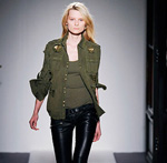 woman modeling military fashion trend on runway