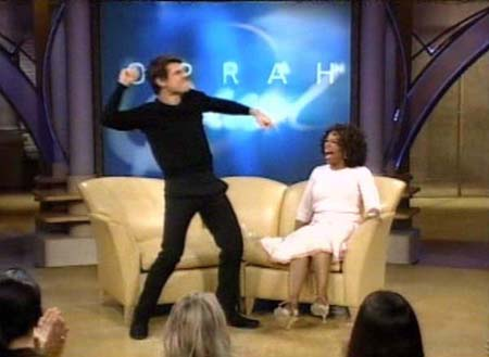 http://cdn.sheknows.com/articles/2011/05/Home/Oprah_/tom_cruise_pink_outfit-s.jpg