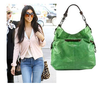 Kourtney Kardashian wearing a cute cardigan over tank top and a cute green purse for summer fashion