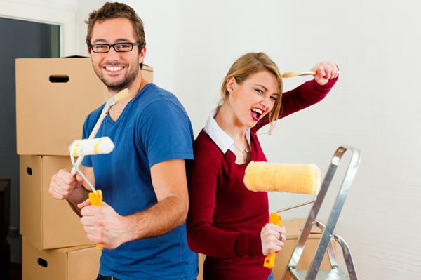 Couple moving in together and decorating