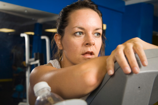 Exhausted woman in gym