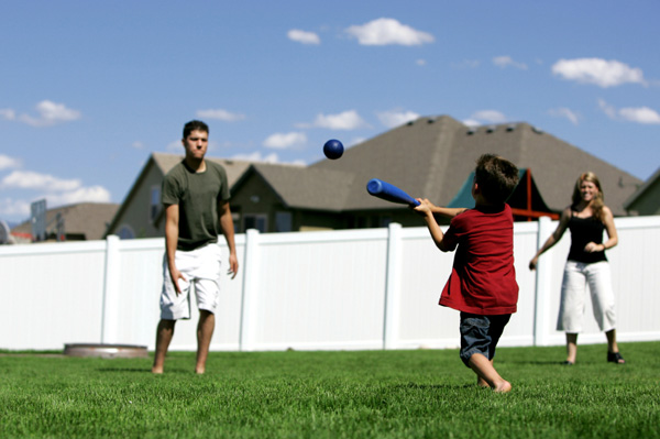 Family playing baseball