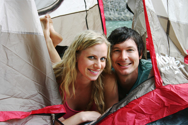 Happy couple camping together