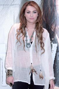 Miley Cyrus defends designer